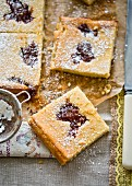 Blondies with peach jam and icing sugar