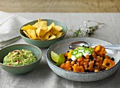Pumpkin chilli with guacamole and tortilla chips