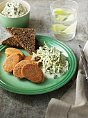 Cooked cod roe with coleslaw and wholemeal bread