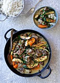 Lamb stew with vegetables and lemon served with rice