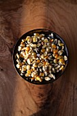 Various types of corn kernels in a bowl