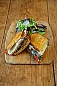 A toasted pork sandwich with salad