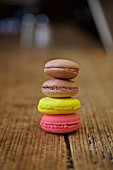 A stack of macaroons on a wooden table
