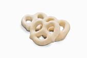Three mini white chocolate pretzels (close-up)