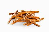 A pile of pretzel sticks on a white surface