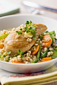 Chicken breast on a bed of vegetable barley