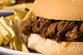 A pulled pork sandwich with parsnip fries