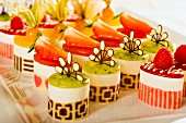 Various petit fours with strawberries and exotic fruits
