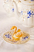 A choux pastry swan with cream and icing sugar