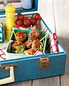 Meatballs with colourful skewers for a picnic