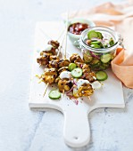 Tandoori chicken skewers with yoghurt sauce and pickled cucumber
