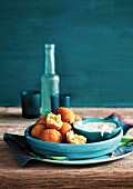 Swordfish and parsnip balls in breadcrumbs with a yoghurt dip