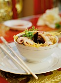 Noodles with squid and Chinese-style mushrooms