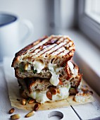 A toasted sourdough sandwich with goat's cheese and pine nuts