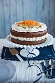 A creamy cake on a cake stand