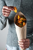 A cone of Batata Harra (spicy potatoes with coriander, Lebanon)