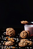 Oat cookies with raisins and chocolate chips served with a glass of milk