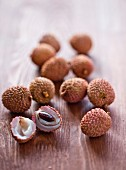 Lychees on a wooden surface