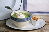 Pea soup with croutons and a poached egg