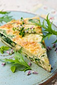 A slice of potato frittata with herbs