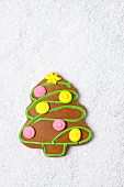 A gingerbread Christmas tree on grated coconut