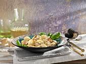 Gnocchi al tartufo (gnocchi with grated truffles, Italy)