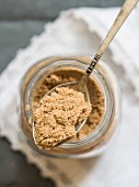 Organic African baobab powder in a jar and on a spoon