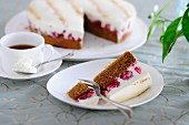 Raspberry and sour cream cake served with a cup of coffee