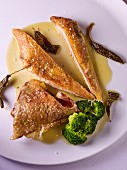 Chicken breast with fried herbs and broccoli