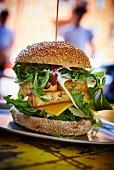 A cheeseburger with halloumi in a restaurant