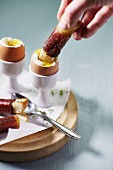 Soft boiled eggs and bacon sticks for breakfast