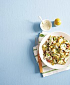 Potato salad with gherkins, ham and yoghurt dressing