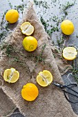 Lemons and thyme on a linen cloth