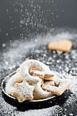 A selection of biscuits with icing sugar