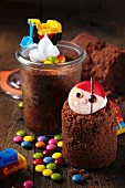 Chocolate trail mix cake baked in jars decorated with colourful chocolate beans and toys