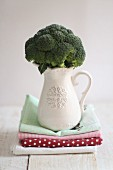 Broccoli in a white porcelain jug