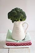Broccoli in a white porcelain jug