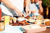Burgers being made at a barbecue party