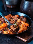 Beef ragout with vegetables in a pan