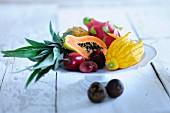 A bowl of exotic fruit