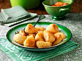 Roast potatoes on a green ceramic plate