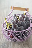 Freshly washed red grapes in a wire basket