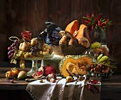An autumnal arrangement featuring vegetables, mushrooms and fruit