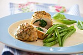 Chicken breasts filled with spinach served with green beans