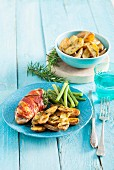Chicken fillet wrapped in bacon served with baby potatoes, rosemary and green beans