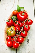 Various tomatoes in a wooden dish