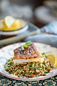 Fried fish fillet on a bed of tabbouleh (Morocco)