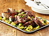 Pork with sesame seeds and Brussels sprouts