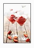Strawberry granita in two stemmed glasses