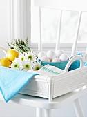 Eggs, asparagus, and lemons in basket